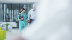 Man comforted by caring medical staff. Assisting people when life throws - stock footage