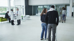 Assisting people when life throws unexpected obstacles in your way. A hospital - stock footage
