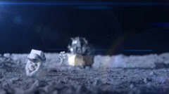 Astronaut on the moon surface.  The lunar lander is blurred in the distance and - stock footage