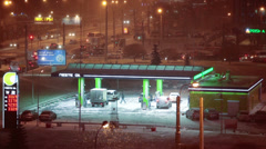 Neste petrol station during a first snowfall, St. Petersburg, Russia Stock Footage