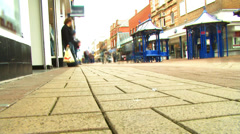 Time lapse of shoppers walking through busy uk commercial area Stock Footage