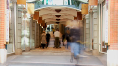 Colorful technicolor time lapse of shoppers and pedestrians visiting a shopping Stock Footage