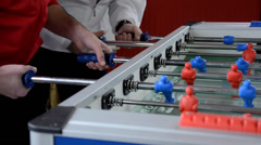 Playing foosball Stock Footage