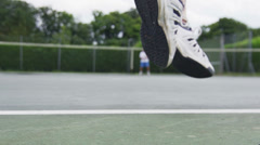 Low angle view of tennis players on court Stock Footage