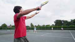 Tennis serve in slow motion from behind player.  Sport in action. Stock Footage