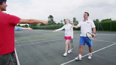 Tennis players shake hands at the net Stock Footage