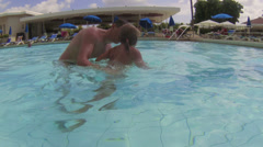 Father giving swimming lessons in waterpool with preschooler child Stock Footage