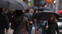 New York pedestrians in the rain Stock Footage