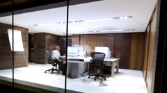 Time lapse modern business at night. Staff working late into the evening in Stock Footage
