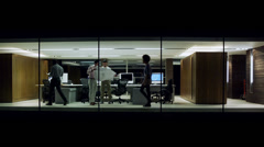 Office people walk between corporate floors in glass building. - stock footage