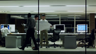 Stock Video Footage of Office business evening - Office people with computers and plans in modern glass