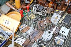 old metal tools at a flea market. - stock photo