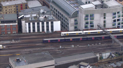 Stock Video Footage of Aerial view of passenger trains passing at a London city station
