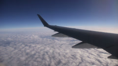 Airplane wing above clouds - stock footage