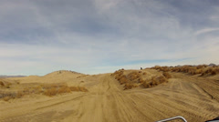 RZR chasing motorcycle rough desert trail POV HD 0033 Stock Footage