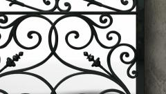 Ornate gates with wall pan Stock Footage