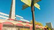 Stock Video Footage of Asheville, NC City Signage Tilting-down to Sightseeing Trolley Tour