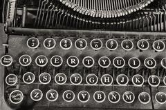 an antique typewriter showing traditional qwerty keys - stock photo