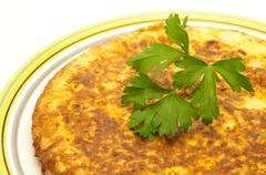 spanish omelette with parsley - stock photo