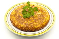 Spanish omelette with parsley Stock Photos