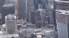 Aerial view above office buildings and skyscrapers in the city of London Stock Footage