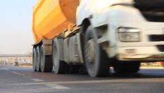 Close-up of running dump trucks Stock Footage
