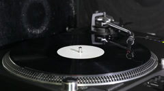 Dj turntable needle and on vinyl - stock footage