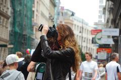 Fotografin in der stadt Stock Photos