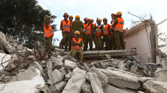 Soldiers search for rocket attack casualties digging through the rubble Stock Footage