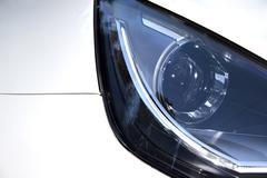 Extreme close up of vehicle left headlamp Stock Photos