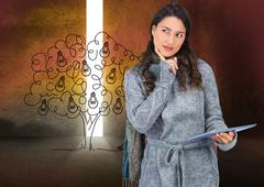 Stock Illustration of Composite image of pensive model wearing winter clothes holding her tablet