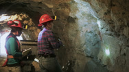 Stock Video Footage of Female geologists in underground tunnel