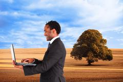 Composite image of businessman working on laptop Stock Illustration