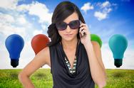 Composite image of serious elegant brunette wearing sunglasses on the phone Stock Illustration
