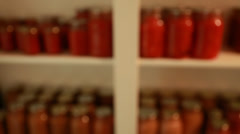 freshly preserved food in jars in storage room rack focus - stock footage