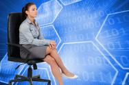 Stock Illustration of Composite image of portrait of a serious businesswoman sitting on an armchair