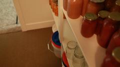 Preserved food in jars in storage room Stock Footage