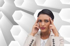 Composite image of young businesswoman putting her fingers on her temples - stock illustration