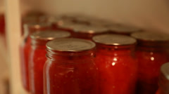 Fresh preserved food in jars in storage room rack focus Stock Footage