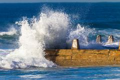 Ocean Wave Hitting Tidal Pool Stock Photos