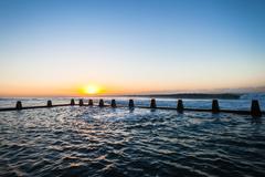 Tidal Pool Sea Water Waves Sunrise - stock photo