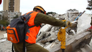 Stock Video Footage of Soldiers search for rocket attack casualties digging through the rubble