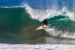 Surfer Inside Hollow Wave - stock photo
