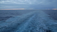 Stock Video Footage of wake of cruise ship at sunrise, sky and water
