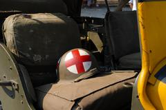 World war two helmet placed on the military truck Stock Photos