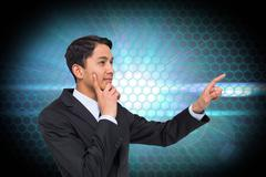 Stock Illustration of Composite image of thoughtful asian businessman pointing