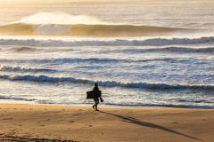 Morning Beach Body-Board Rider Waves - stock photo