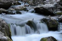 clear cold stream time lapse with slow shutter speed - stock photo