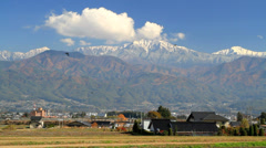 Rural landscape in the Japanese province with mountains in the background. Stock Footage