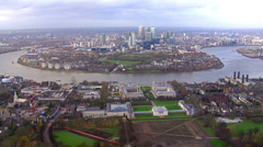 Spectacular panoramic aerial view above the Isle of Dogs in London, England Stock Footage